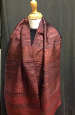 Silk scarf handwoven in reds and pinks in Laos hand tied fringe
