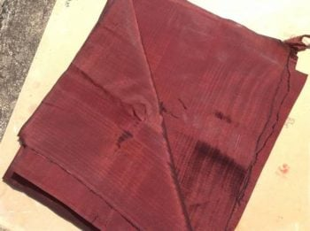 Meters of handloomed silk in a Burgandy colour. Fine weave, use for clothes and furnishing